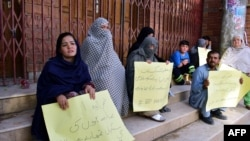 Members of the Hazara community of Shi'ite Muslims protest against the killing of Hazaras in Quetta.