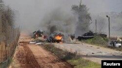 İsrailin Livan sərhədinə yaxın ərazisində hərbi maşınlar yanır, 28 yanvar