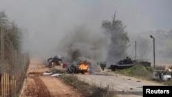 Израильдің Ливанмен шекарасында жанып жатқан әскери көліктер. 28 қаңтар 2015 жыл.