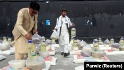 Men prepare free food donated by the Afghan government amid the spread of the coronavirus, in Jalalabad, Afghanistan, on April 28.