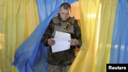 A Ukrainian serviceman after casting his vote in parliamentary elections at a polling station in Novoaidar near Luhansk on October 26.