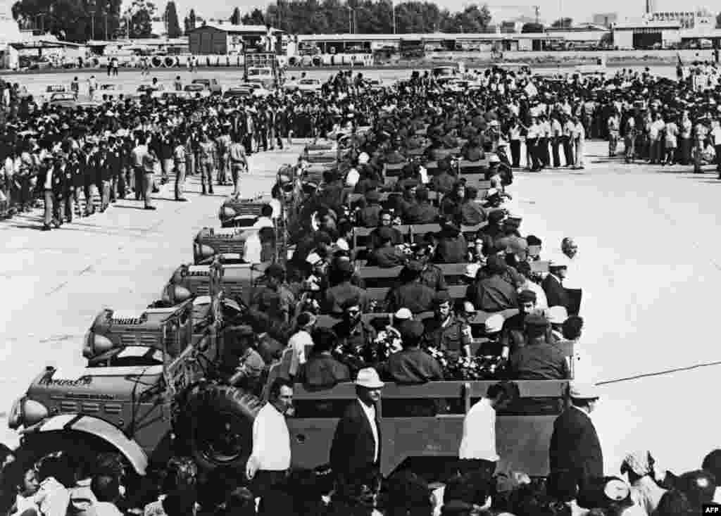 The caskets of Israeli Olympic team members killed by the hostage takers are transported on military vehicles at Lof Airport on September 8, 1972.
