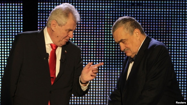Czech presidential candidates Karel Schwarzenberg (right) and Milos Zeman chat before their final televised debate in Prague on January 24.