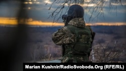 Ukraine -- Soldier looks at the slagheap controled by prorussian rebels from position of the Ukrainian military on the slagheap near the mine of Zolote-4, 13Dec2017
