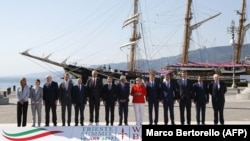 Balkan and EU leaders line up for a photo at the Western Balkans Summit in Trieste, Italy, on July 12. (Left to right: EU foreign policy chief Federica Mogherini, Serbian Prime Minister Ana Brnabic, Montenegrin Prime Minister Dusko Markovic, Austrian Chancellor Christian Kern, Kosovar Prime Minister Isa Mustafa, Albanian Prime Minister Edi Rama, French President Emmanuel Macron, Italian Prime Minister Paolo Gentiloni, German Chancellor Angela Merkel, Slovenian Prime Minister Miroslav Cerar, Chairman of the Council of Ministers of Bosnia and Herzegovina Denis Zvizdic, Croatian Prime Minister Andrej Plenkovic, Macedonian Prime Minister Zoran Zaev and British Foreign Secretary Boris Johnson.)