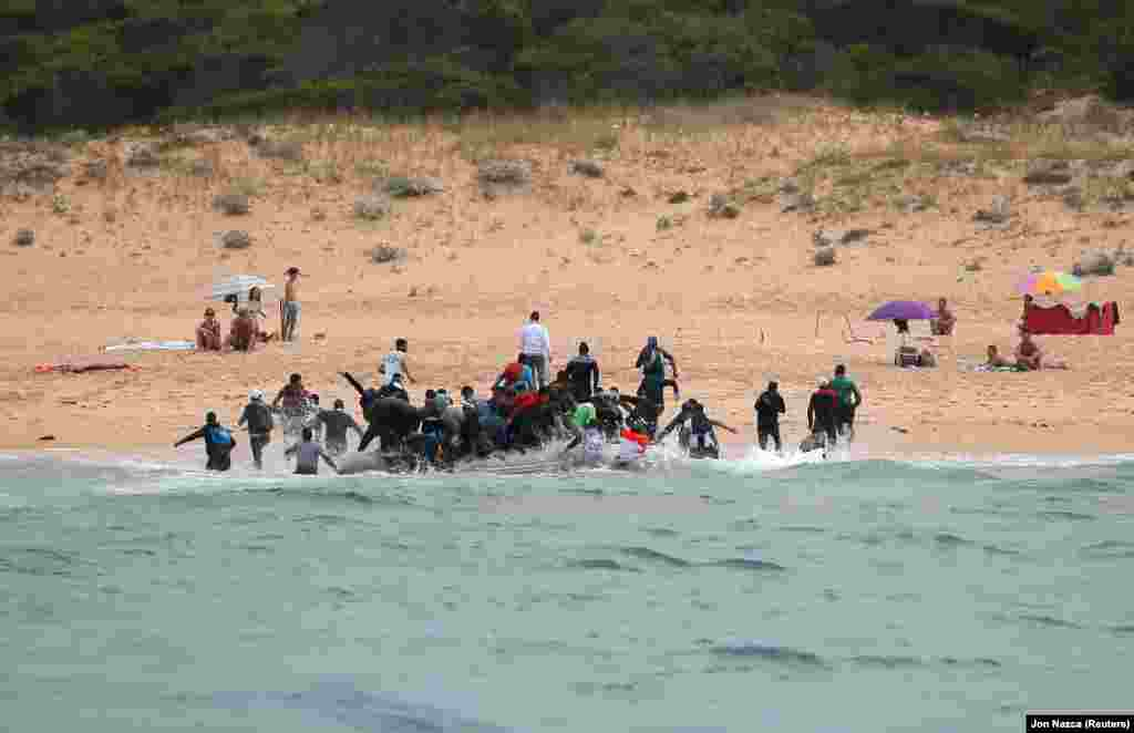 Moroccan migrants disembark from a dinghy in Tarifa, southern Spain, after crossing the Strait of Gibraltar from the coast of Morocco. (Reuters/Jon Nazca)