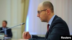 Ukrainian Prime Minister Arseniy Yatsenyuk chairing a cabinet meeting in Kyiv on April 25.