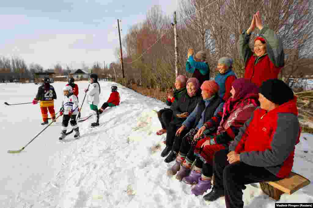 KYRGYZSTAN -- Supporters of Kyrgyzstan's first female hockey team cheer during a training match in the village of Otradnoye, February 4, 2020