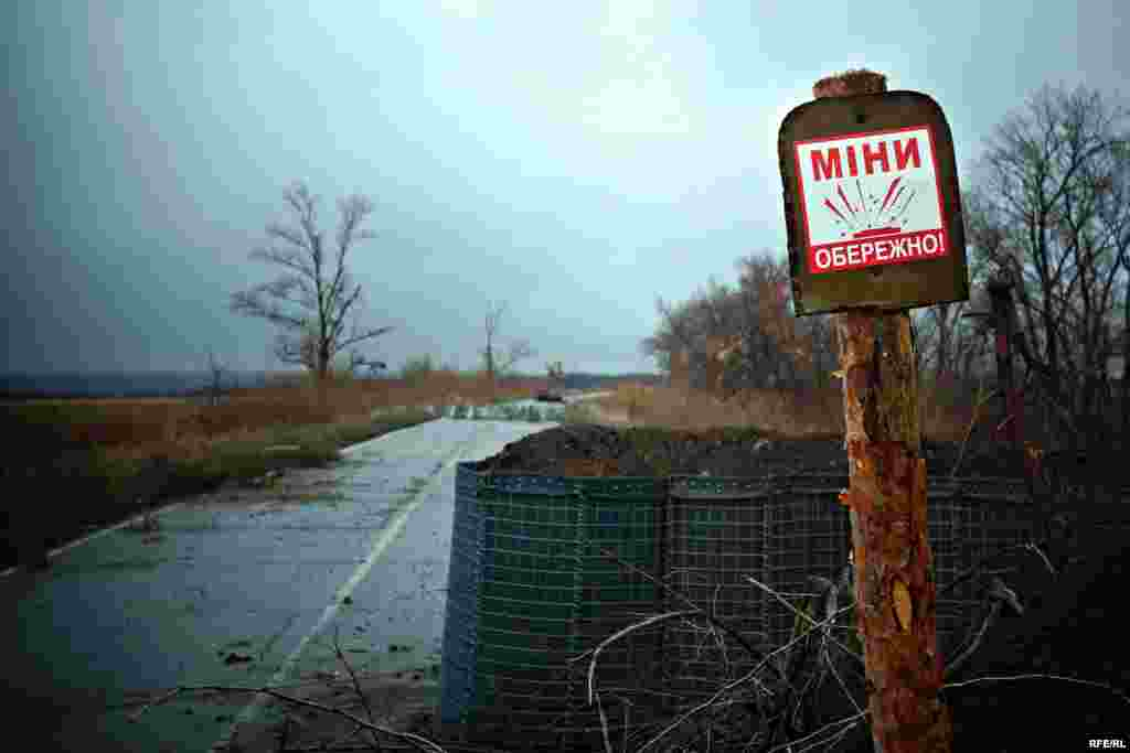 A sign warns about mines on the land ahead. This is the furthest point of the 29th checkpoint along the front line.