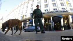 A German police officer with a sniffer dog demonstrates the search for explosives before the start of the 48th Conference on Security Policy in Munich on February 3.