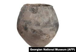 An image released by the Georgian National Museum on November 13 shows a Neolithic jar from Khramis Didi-Gora, Georgia. Pottery fragments from 8,000-year-old jars unearthed near Tbilisi are the earliest evidence of winemaking in the Near East.