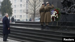 U.S. Secretary of State Rex Tillerson (left) takes part in a wreath-laying ceremony to commemorate International Holocaust Remembrance Day at the Warsaw Ghetto monument in Poland on January 27.