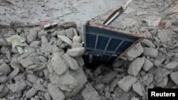 Պակիստան - Երկրաշարժի հետևանքով փլատակների վերածված շինություններ Ավարան բնակավայրում, 25-ը սեպտեմբերի, 2013թ․
