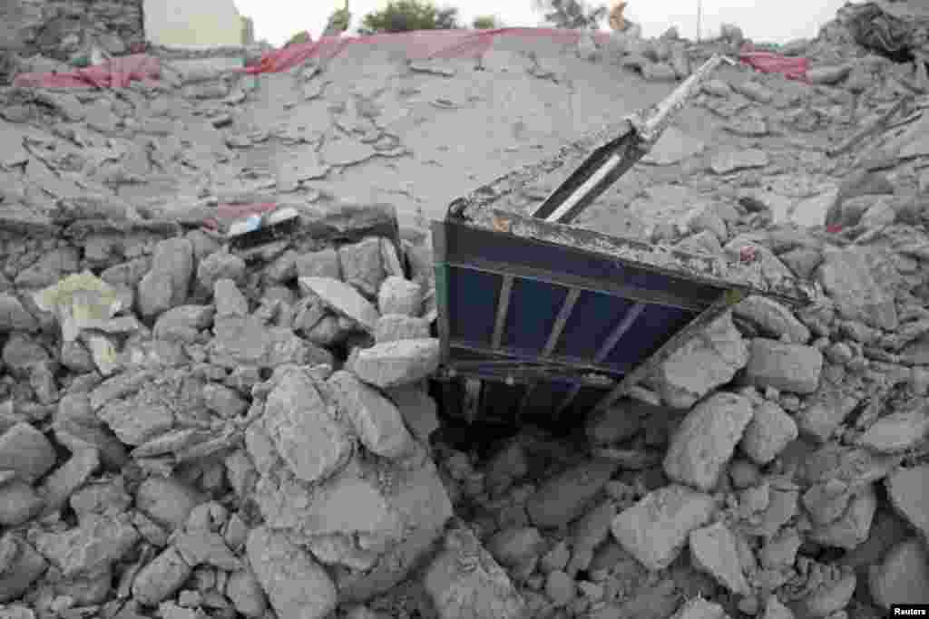 The rubble of a house after it collapsed in the town of Awaran.