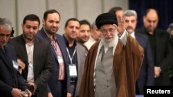 Iran's Supreme Leader Ayatollah Ali Khamenei arrives to cast his vote at a polling station during parliamentary elections in Tehran, Iran February 21, 2020