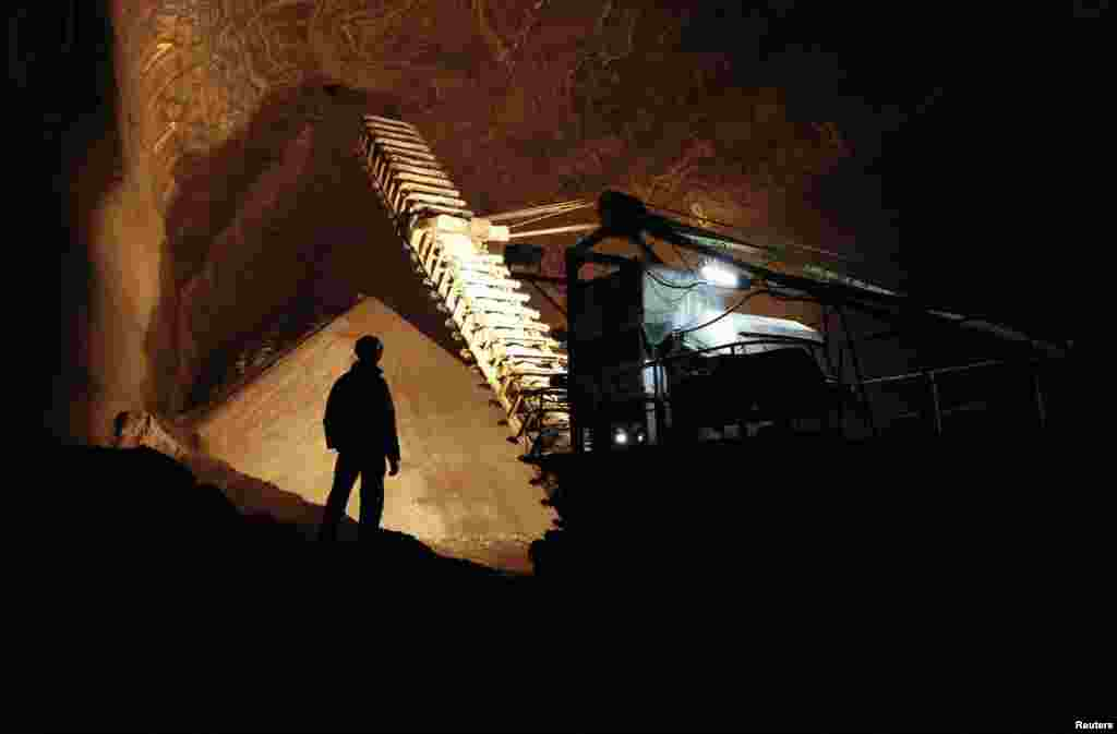 Employees work inside a Uralkali potash mine near the city of Berezniki in the Perm region, close to the Ural Mountains.