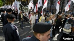 Supporters of Yulia Tymoshenko march on the street near the high court building in Kyiv on August 21.