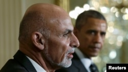 Afghanistan President Ashraf Ghani (left) and U.S. President Barack Obama address a joint news conference in the East Room of the White House in Washington on March 24.