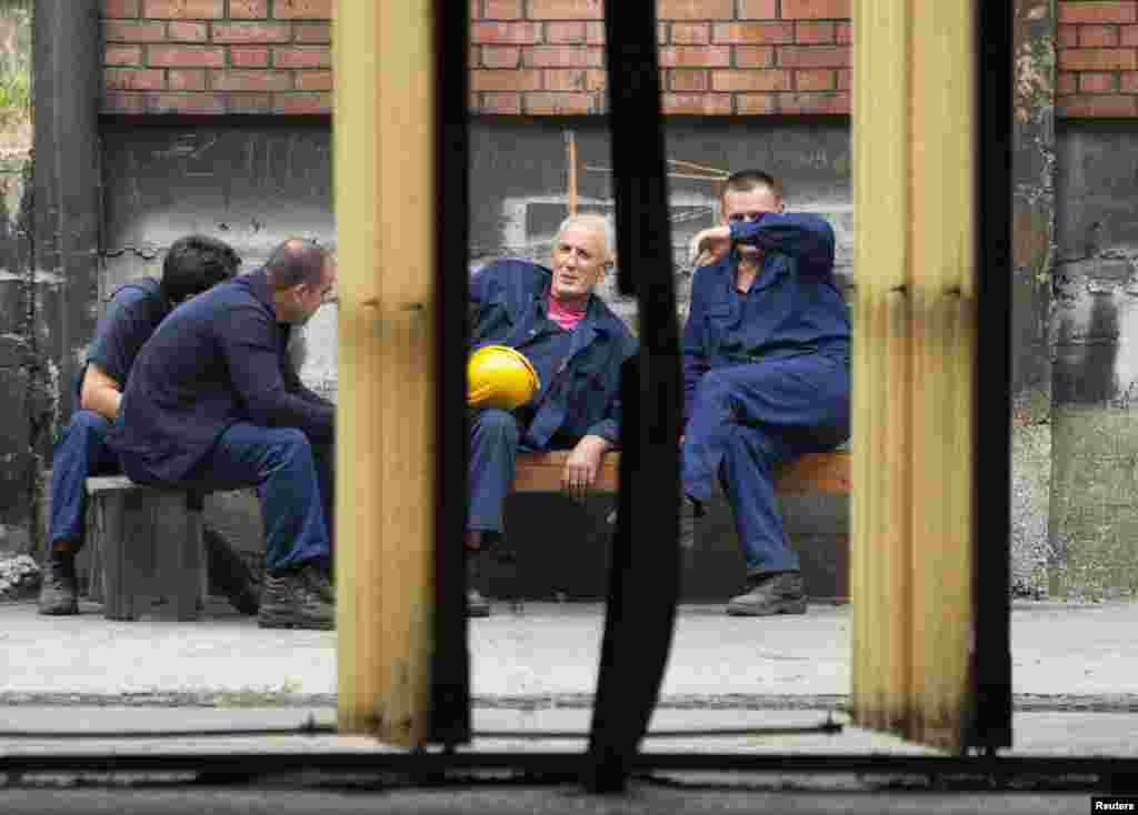 Workers take a break outside the foundry.