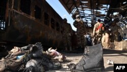په ۲۰۱۴م کال د بلوچستان په سیوۍ کې پر رېل ګاړي د برید یو تصویر