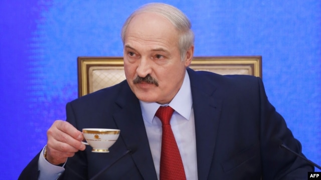 Belarusian President Alyaksandr Lukashenka listens to questions during his seven-hour press conference in Minsk on January 29.