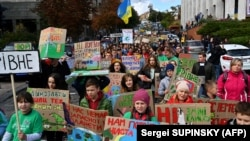 Children protest against climate change in the center of Kyiv on September 20.