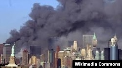 Smoke billows out of the burning World Trade Center towers before their collapse in New York on September 11, 2001.