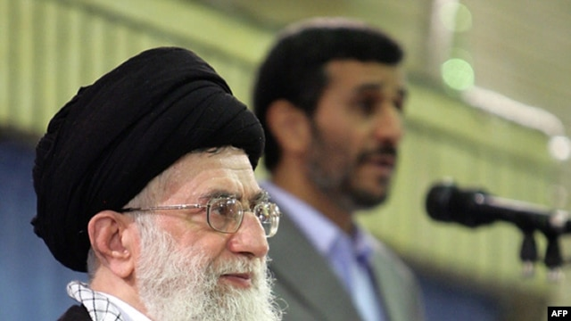 In a photo released by his official website, Supreme Leader Ayatollah Ali Khamenei listens to a speech by President Mahmud Ahmadinejad during an official ceremony in Tehran.