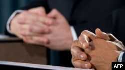 The hands of British Prime Minister Gordon Brown (left) and U.S. President Barack Obama are pictured as they addressed a joint press conference in London on April 1.