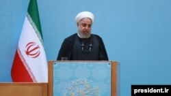 Iranian President Hassan Rouhani delivering a speech, August 28, 2019, where he complained about his lack of authority.