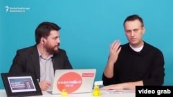 Aleksei Navalny (right) has a YouTube channel that currently has more than 1.6 million subscribers. (file photo)