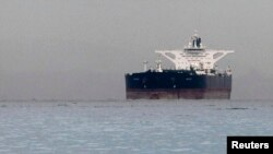 "At Sea -- Malta-flagged Iranian crude oil supertanker ""Delvar"" is seen anchored off Singapore, 01Mar2012"