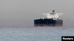 "File photo - Malta-flagged Iranian crude oil supertanker ""Delvar"" is seen anchored off Singapore, 01Mar2012, during international sanctions on Iran for its nuclear program."