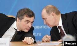 Vladislav Surkov (left) talks with Vladimir Putin at a meeting in 2012.