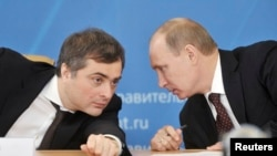 Vladislav Surkov (left) has long had Vladimir Putin's ear on policy, both domestic and foreign.