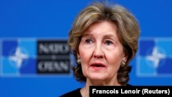 U.S. Ambassador to NATO Kay Bailey Hutchison briefs the media ahead of a NATO defense ministers meeting at the alliance headquarters in Brussels on October 2.