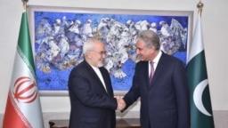 FILE: Iranian Foreign Minister Javad Zarif with Foreign Minister Shah Mahmood Qureshi in Islamabad (August).
