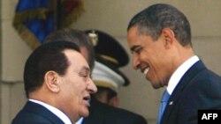 Egyptian President Hosni Mubarak greets U.S. President Barack Obama in Cairo last June.
