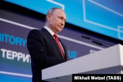 Russian President Vladimir Putin delivers a speech in Arkhangelsk on March 30.