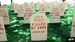 Activists erected a mock graveyard across from the United Nations to highlight the need for an arms treaty.
