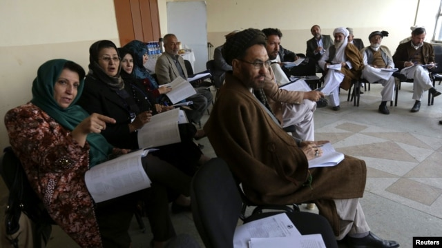 Members of the Loya Jirga, or grand council, take part in a committee session in Kabul on November 22.