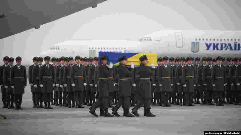 Soldiers carry a coffin containing the remains of one of the 11 Ukrainian victims of the Ukraine International Airlines Flight PS752 plane disaster.