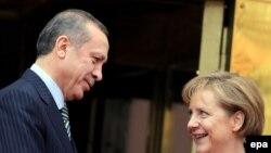 Turkish Prime Minister Recep Tayyip Erdogan (left) meets with German Chancellor Angela Merkel.
