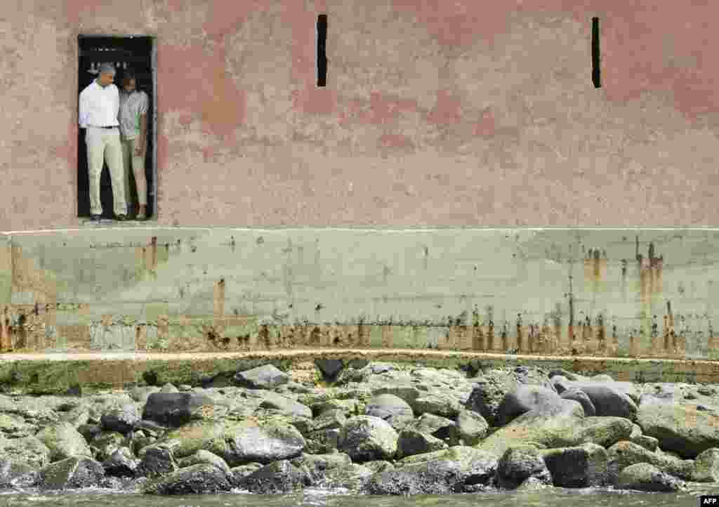 """U.S. President Barack Obama and first lady Michelle Obama are pictured at the """"Door of No Return"""" as they visit the Maison Des Ecslaves, the gathering point where African slaves were shipped west until the mid-19th century, at Goree Island near Dakar, Senegal. (Reuters/Jason Reed)"""