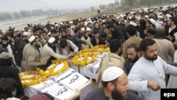 FILE: Supporters attended a mass funeral for nine militants in Dir. They were believed to be killed in a U.S. airstrike in neighboring Afghanistan.