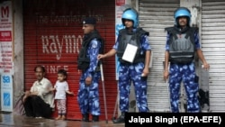 Indian security personnel stand guard on the streets of Jammu.
