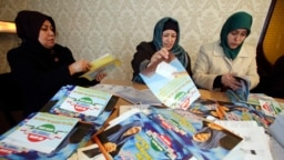 Supporters of the Islamic Renaissance Party of Tajikistan sort leaflets in Dushanbe in February 2015. For the first time in 20 years, the party will not be participating in parliamentary elections being held on March 1.