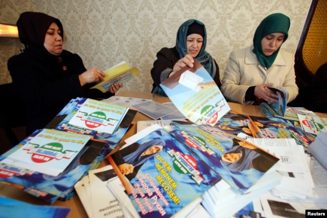 IRPT supporters sort preelection leaflets at the party's headquarters in Dushanbe. In the end, the party garnered a mere 1.5 percent in Tajikistan's March 1 vote.