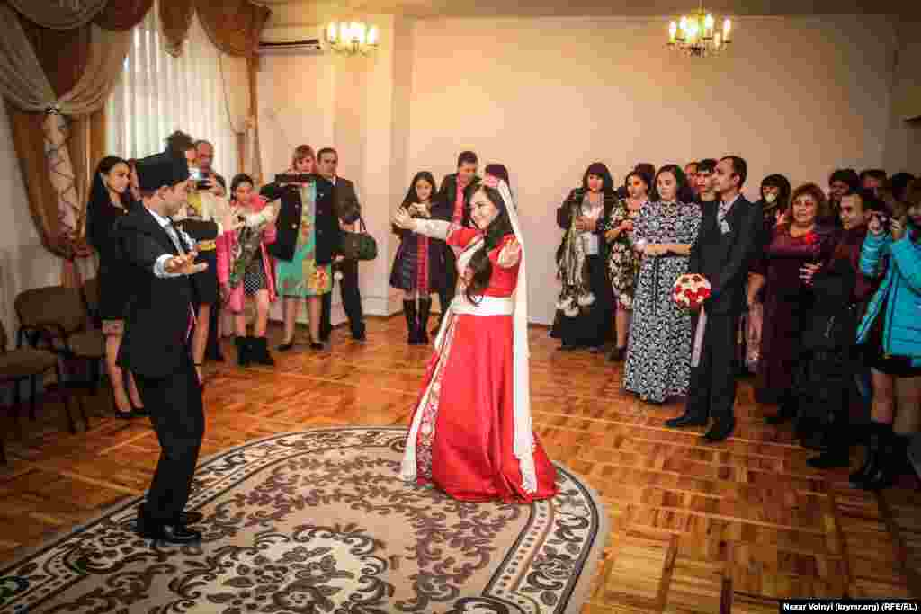 The bride and groom take the lead in dancing after the civil formalities have been taken care of.