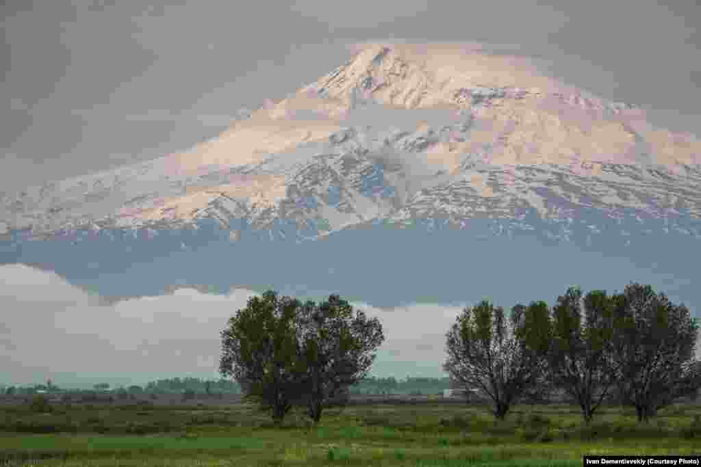 A village lies below Mount Ararat -- a dormant volcano located in what is today eastern Turkey, but which plays a significant role in Armenian history.